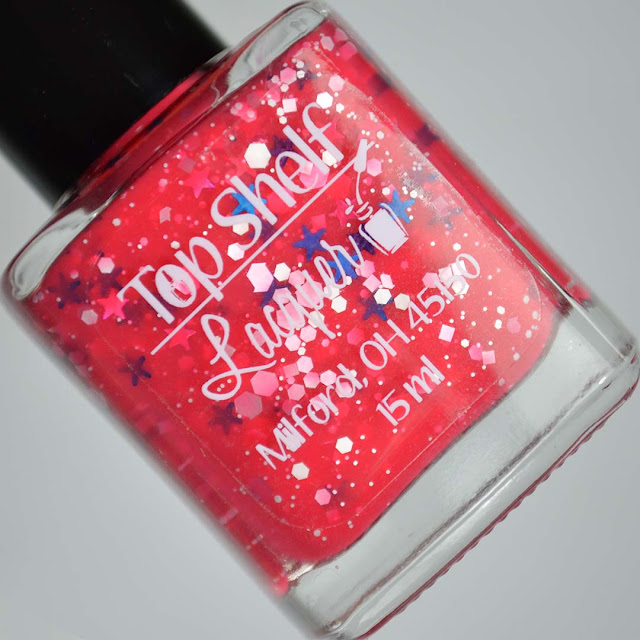pink nail polish with glitter in a bottle