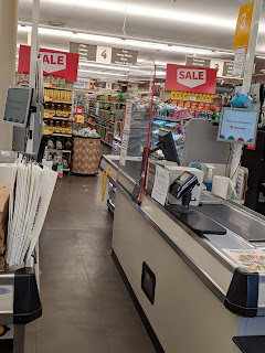 A check out lane at a grocery store.