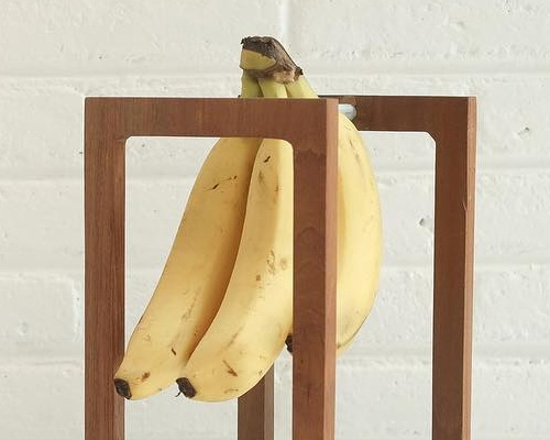 Tinuku Undhagi studio designed dessert banana holder using premium teak wood as well dining table décor
