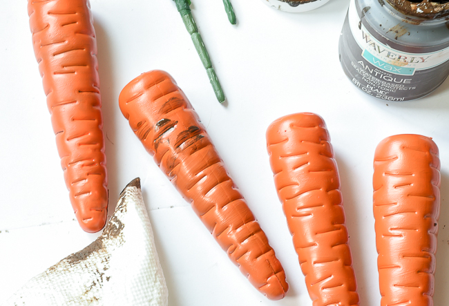 Add antique wax to painted carrots