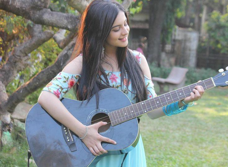 aadhya tunishsa with guitar cute photo