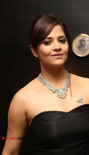 Telugu Anchor Actress Anasuya Bharadwa Stills in Strap Less Black Long Dress at Winner Pre Release Function  0003.jpg