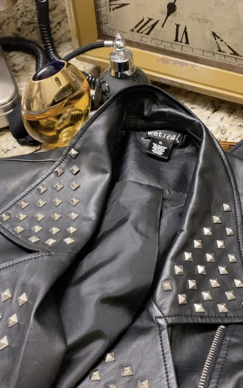 How to wear a rhinestone vest for a Gothic and grunge style.