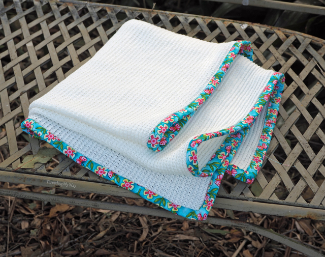 Add a pop of colour to a small blanket with binding on the edges ~ Threading My Way