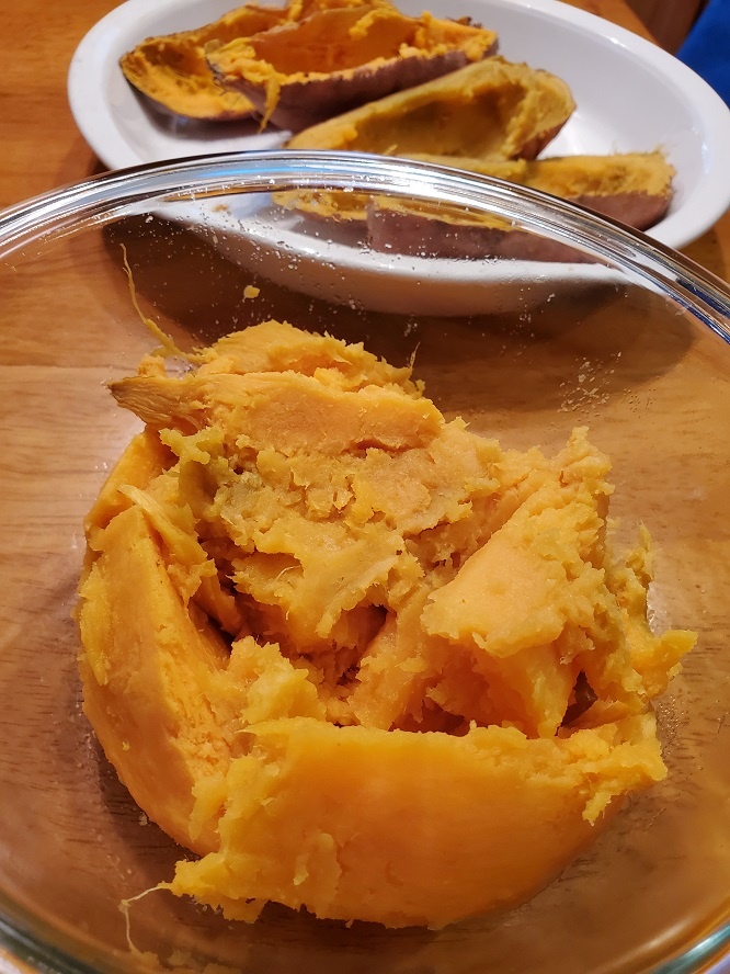 this is the cooked sweet potatoes in a bowl mashed