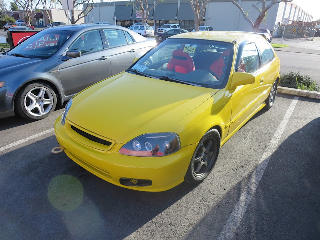 Honda Civic with screaming yellow paint from Almost Everything Auto Body