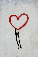Drawing of a stick figure hanging from a red heart