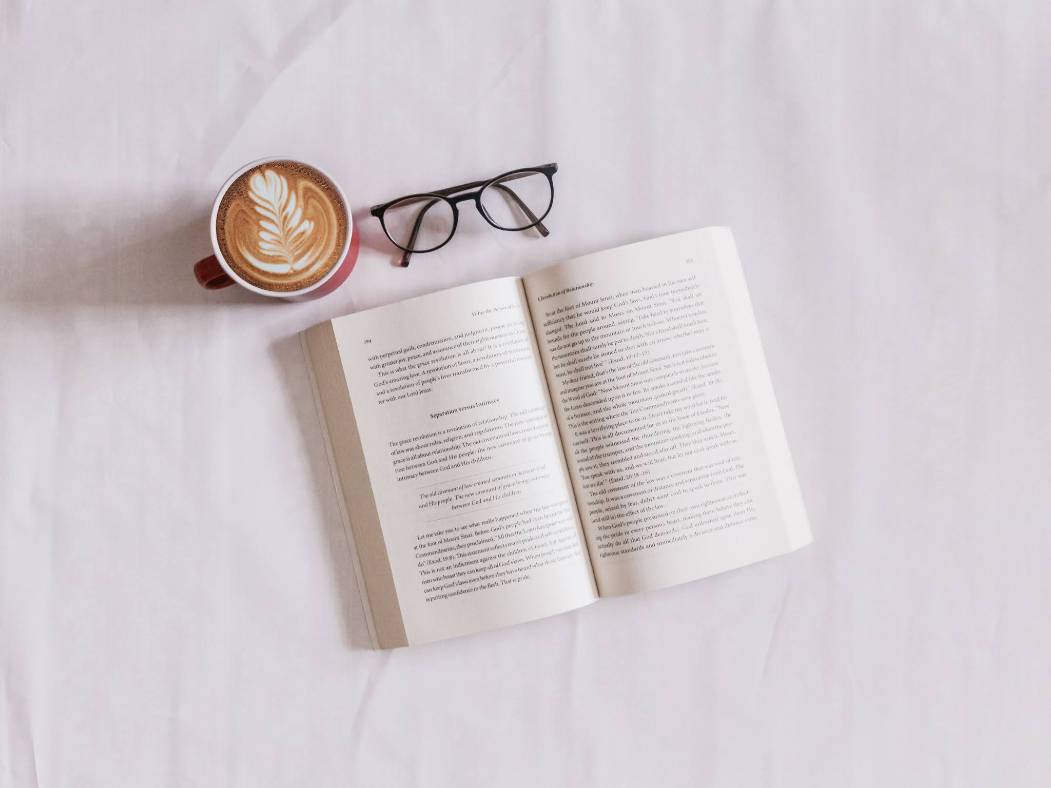 book near glasses and coffee mug