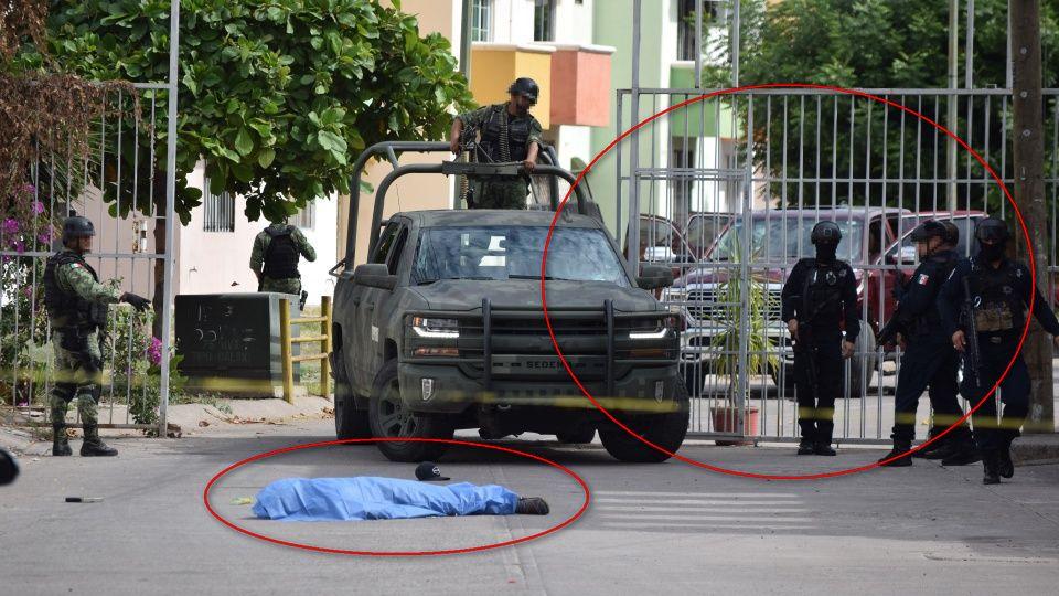 En Culiacán Grupo Armado ejecuta a un encapuchado cuando bajaba de su troca, no le dio tiempo de accionar su arma