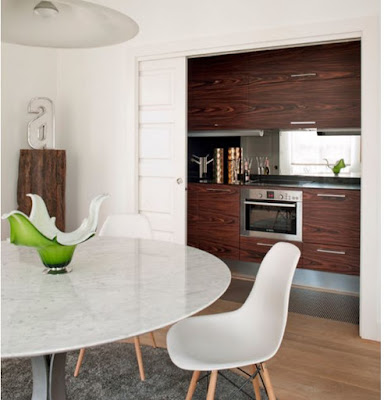 contemporary hidden kitchen design ideas - with sliding door