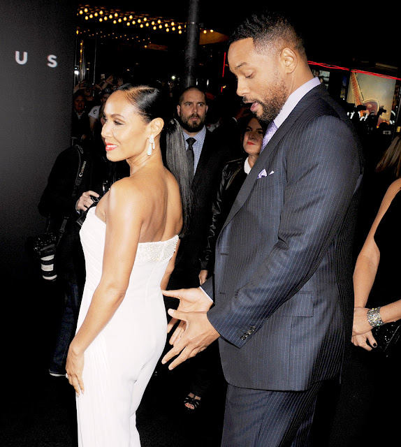 Will Smith gettting handsy with his wife Jada Smith at the Focus premiere party 2015.