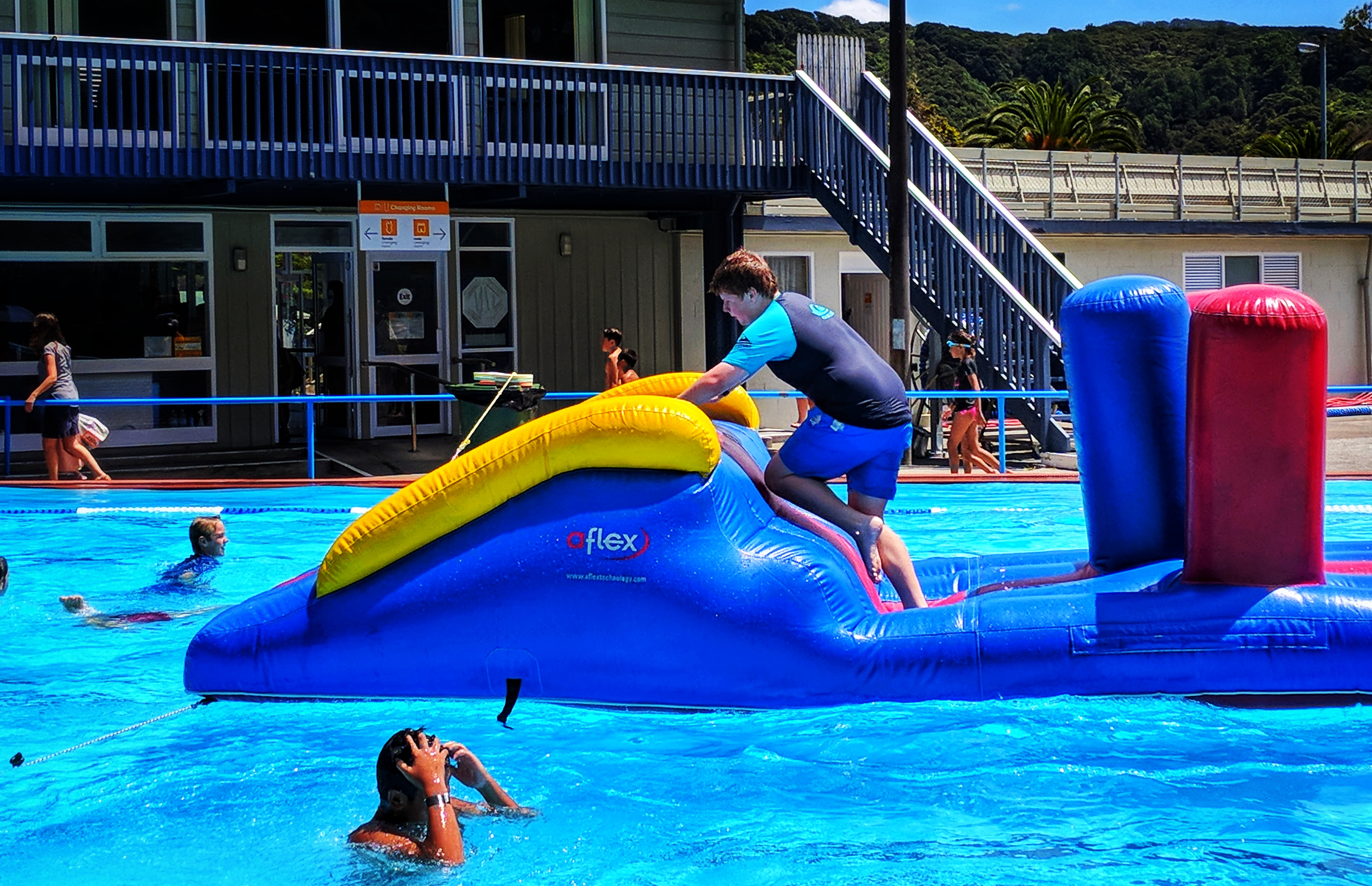 Boy completed a swimming pools inflatable assault course