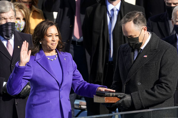 With her husband Doug Emhoff holding two Bibles, Kamala Harris takes the oath of office as she is sworn in as the 49th Vice President of the United States...on January 20, 2021.