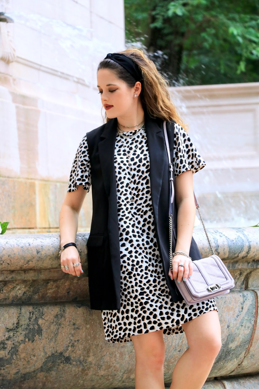 Nyc fashion blogger Kathleen Harper wearing a leopard dress in fall 2018