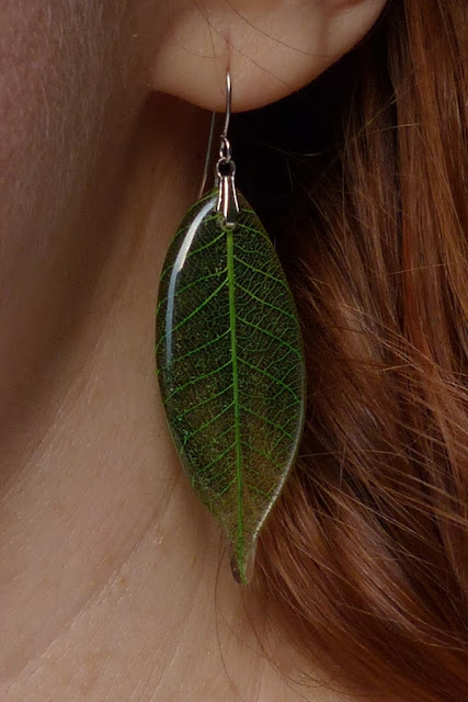 Green glass earrings in shape of leaves
