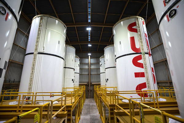 Eight of the ten segments that will form the Space Launch System's twin solid rocket boosters are placed inside the Rotation, Processing, and Surge Facility at NASA's Kennedy Space Center in Florida.