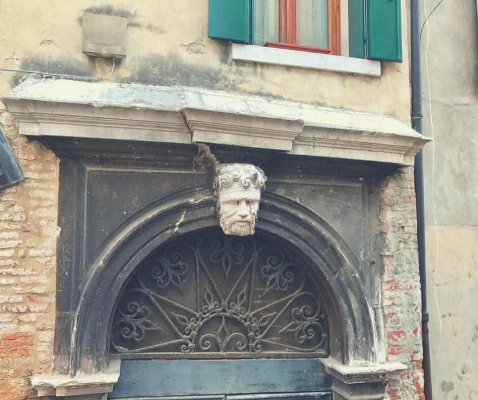 statue head above door in Venice