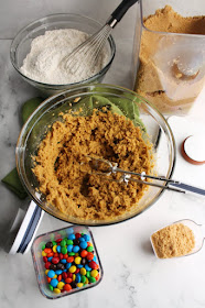 bowl of wet blondie ingredients, bowl of dry blondie ingredients and various components in oxo pop containers