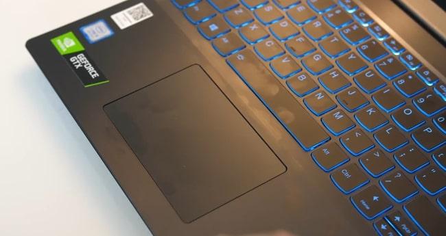 Fingerprints on the smooth matte plastic surface of Lenovo IdeaPad L340 laptop.