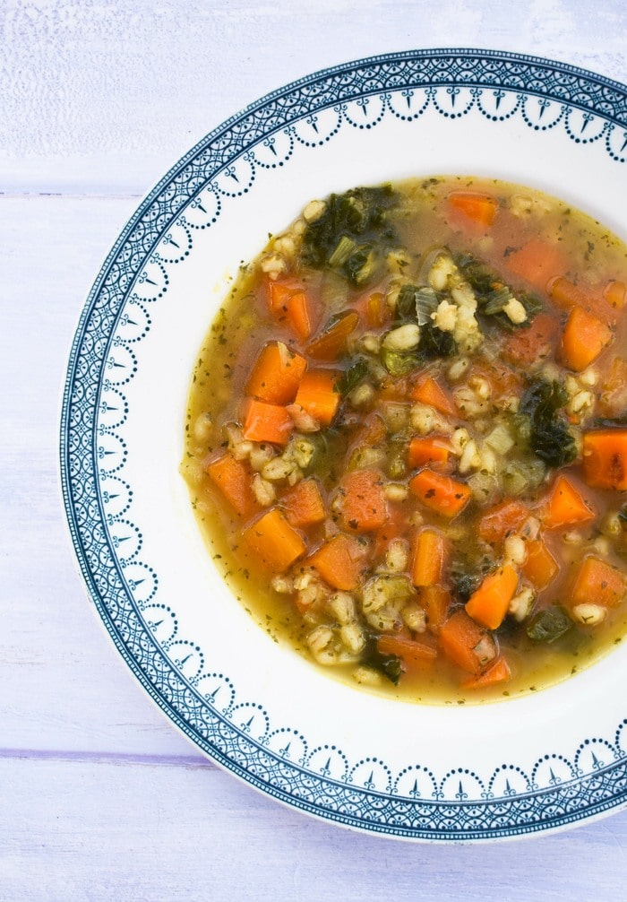 Scotch broth in a white bowl with a patterned blue trim