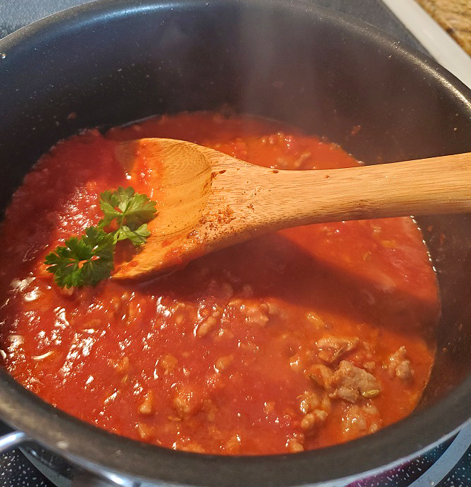 this is a fresh pot of bolognese sauce to top Polenta