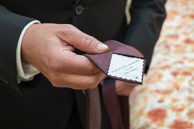 Detail shot of groom's tie Magnolia Farm Asheville Wedding Photography captured by Houghton Photography