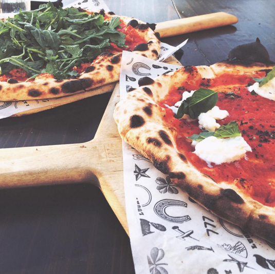 Burrata and Arugula pizzas at Lucky Penny in Santa Barbara