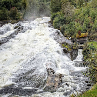 Mill at Hellesylt waterfall on Geirangerfjord in Norway