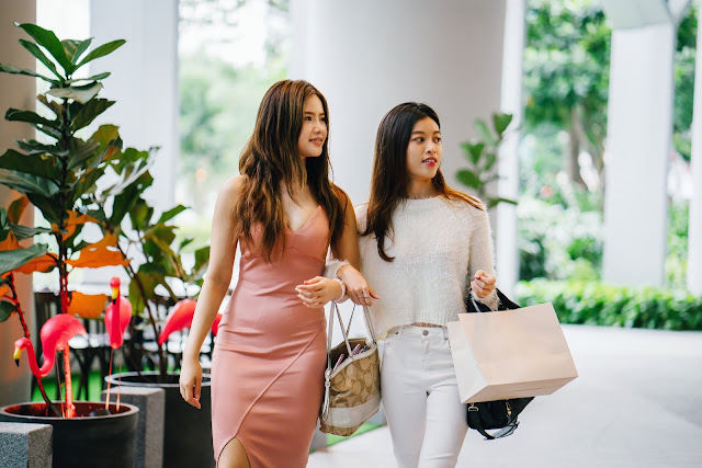 Two Asian girls shopping.