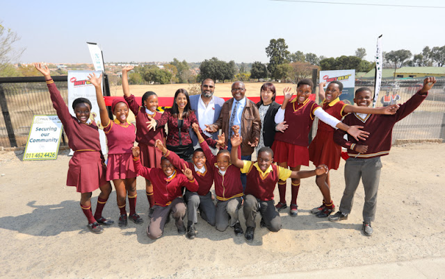 Lisa Sukdev, Lloyd Madurai, Caroline Naidu, Philemon Mashimbyi and excited Witkoppen Primary School learners