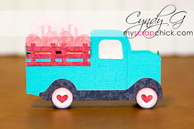 3d card shaped like a truck with hearts in the bed