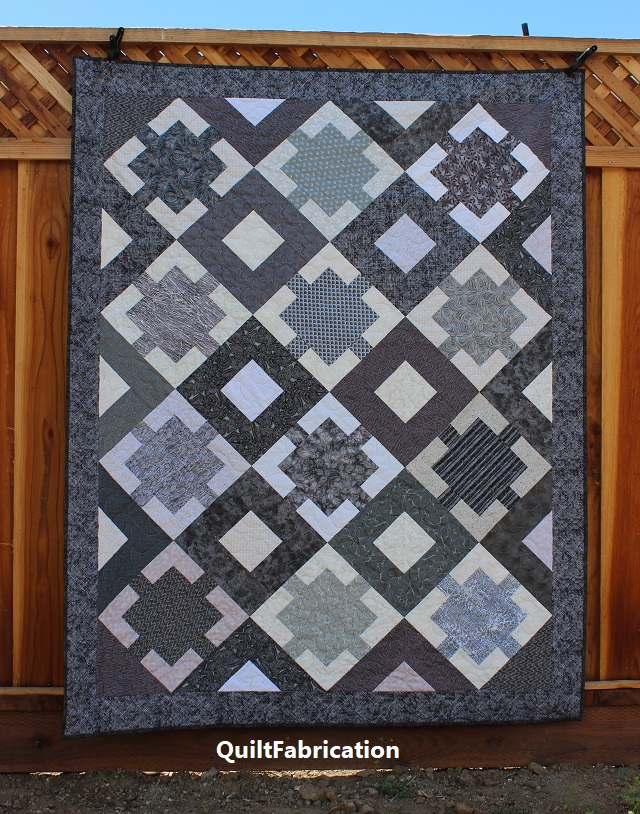 Monochrome quilt pattern in a lap size by QuiltFabrication