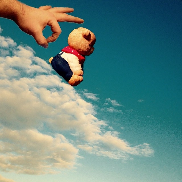 14-A-Nudge-to-Enjoy-Life-Marcus-Einspannier-Surreal-Digital-Photo-Manipulation-using-Clouds-www-designstack-co