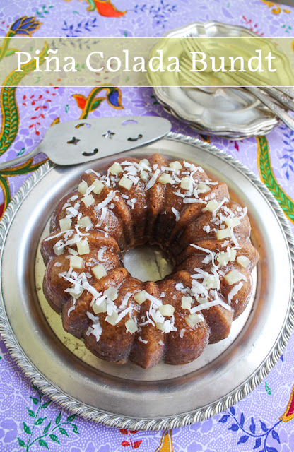 Food Lust People Love: A delicious treat of the tropical cocktail in cake form, this Piña Colada Bundt Cake is made with pineapple, coconut cream and, of course, rum. It is brushed after baking with a coconut pineapple rum syrup/glaze.