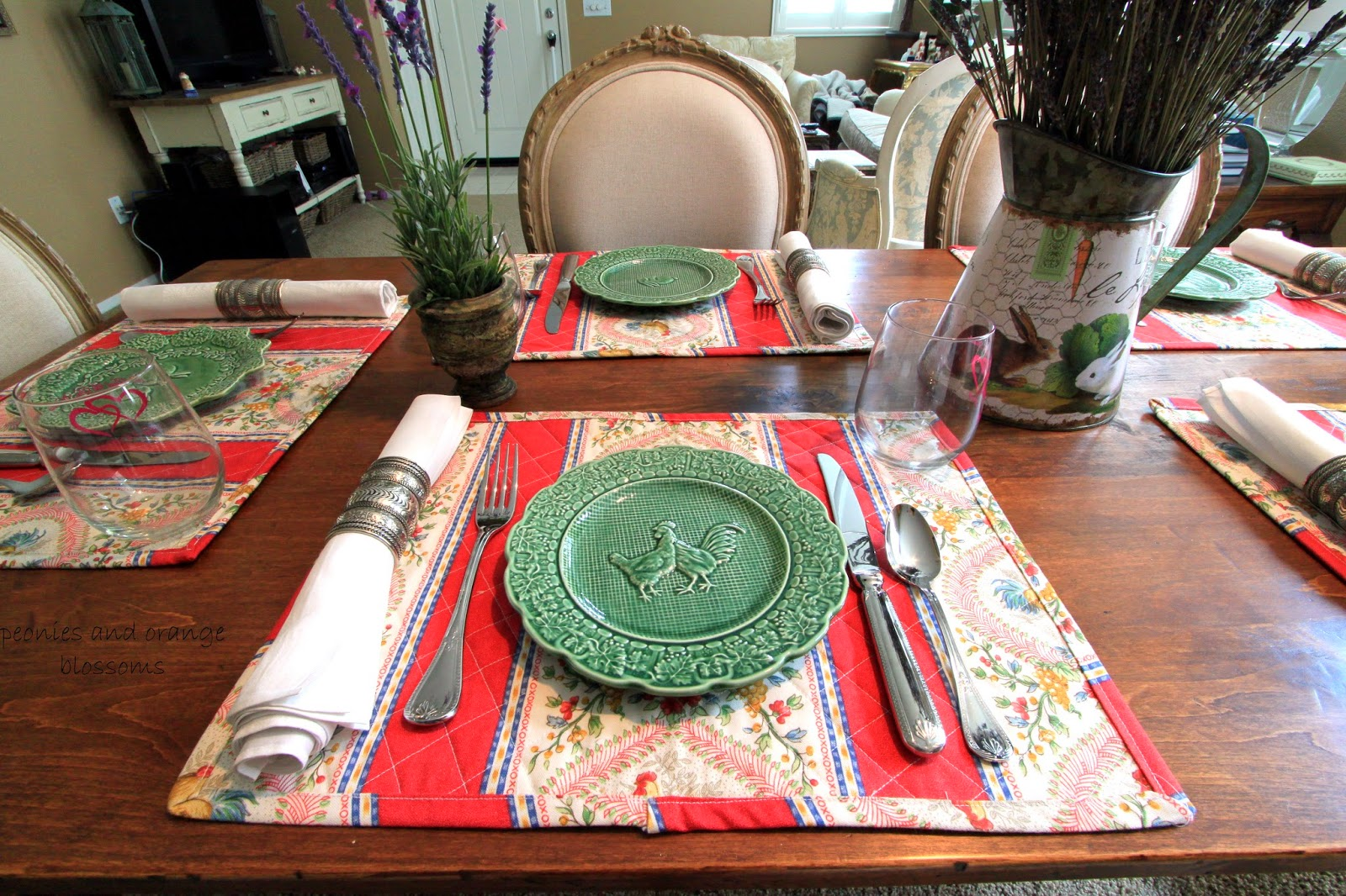 French country table with French rooster placemats, lavender, and green plates - Peonies and Orange Blossoms