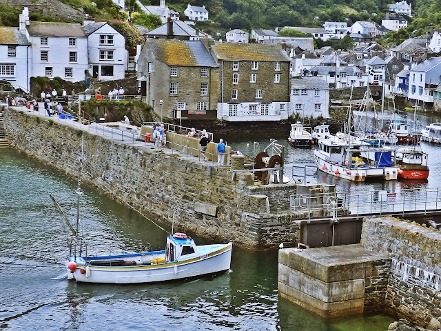 Small boat entering the harbour at Polperro, Cornwall
