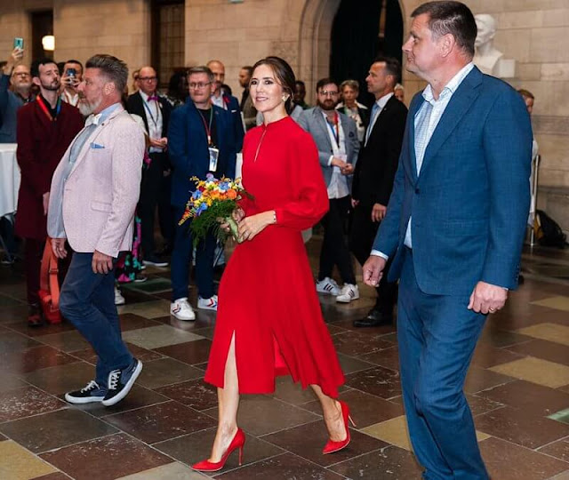 Crown Princess Mary wore an Armonia red silk georgette dress by Raquel Diniz. Gianvito Rossi. Rebekka Notkin carved gold earrings