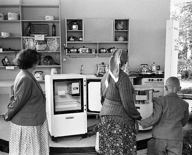 Russian visitors at the 1959 American National Exhibition in Moscow are looking at USA kitchen conveniences