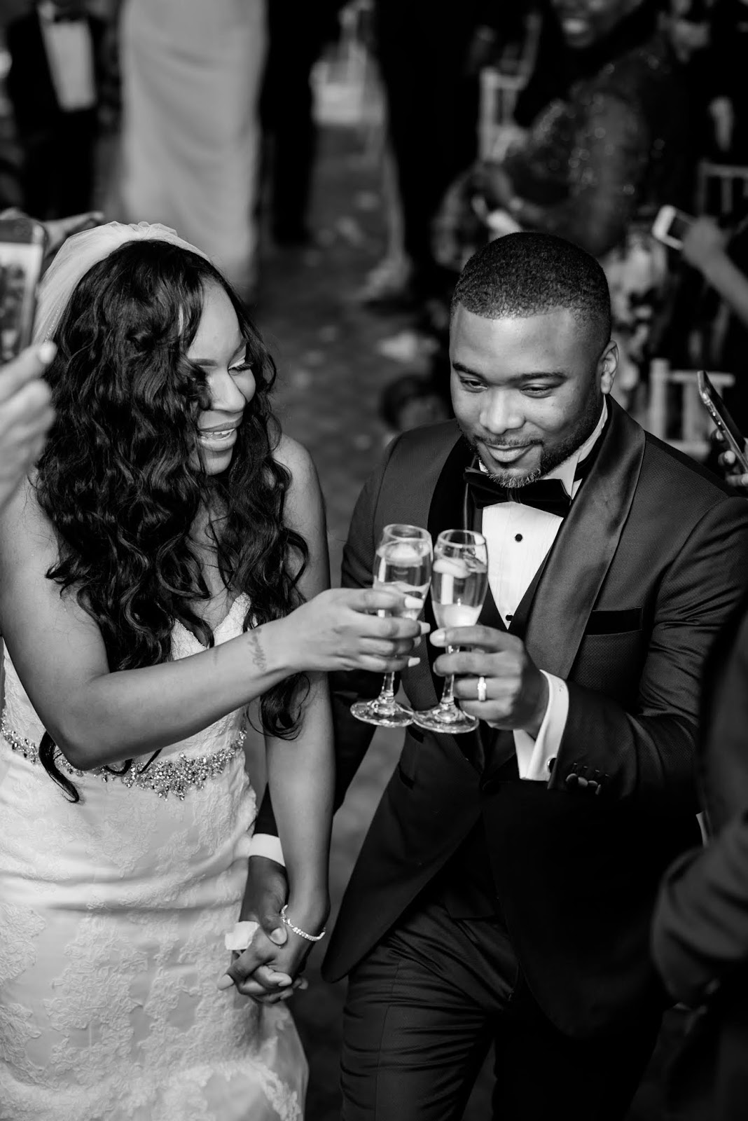 The couple sharing a toast for a successful memorable day