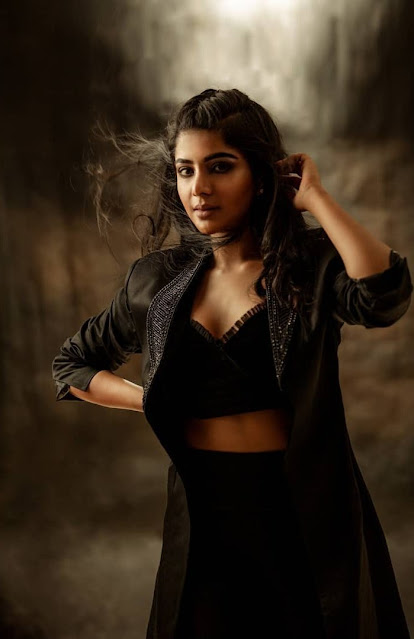 Actress Pavithra Lakshmi New Photoshoot Stills in Black Coat Shows Off Her Sexy Cleavage Navel Queens