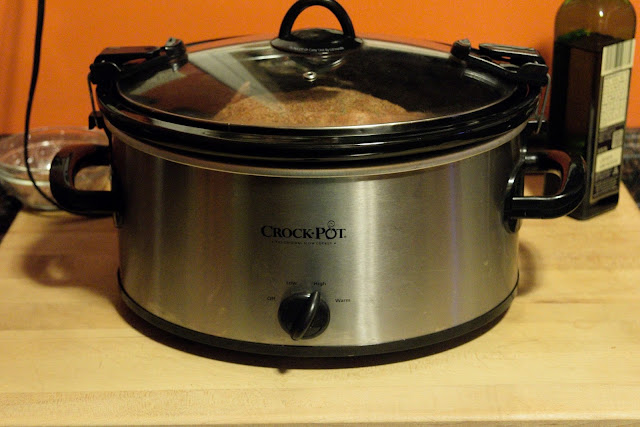 The crock pot on the counted, with the lid on, turned to HIGH.