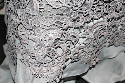 http://www.fashionmia.com/Products/ladylike-round-neck-lace-shirt-19903.html