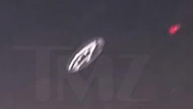 Flying Saucer posted by TMZ website about Los Angeles over a highway.