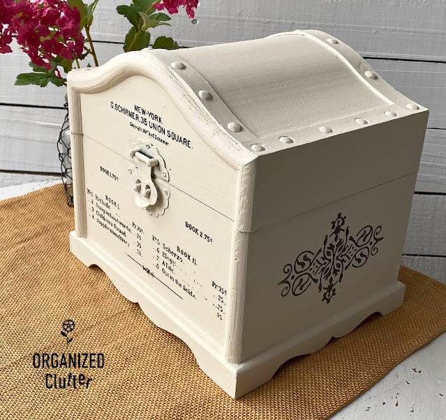 Photo of a wooden treasure chest upcycled with paint and a decor transfer.