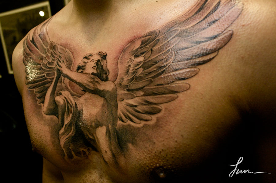 angel wings tattoo on chest for men