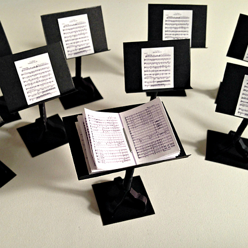 paper music stands with sheet music