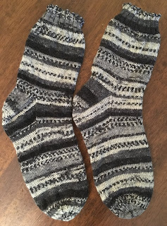 Socks are knitted with wedge toes, traditional heel flap, and toes and heels are reinforced