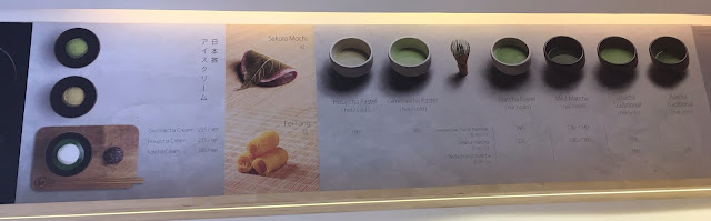 many types of matcha tea on a menu board