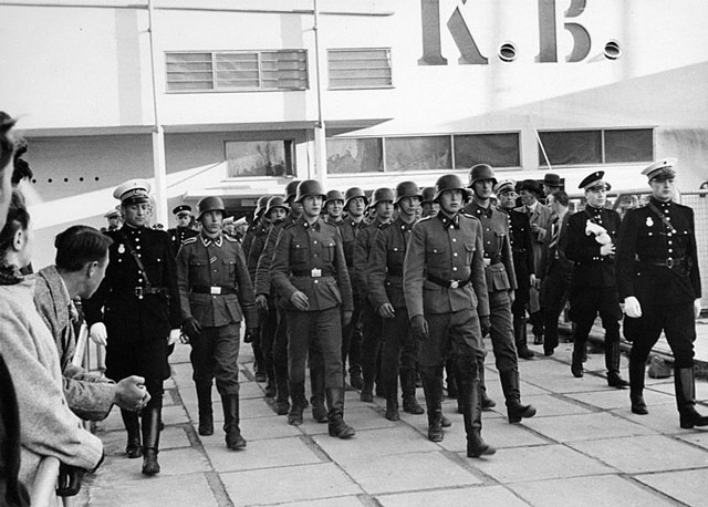 Danish DNSAP members marching 26 April 1942 worldwartwo.filminspector.com
