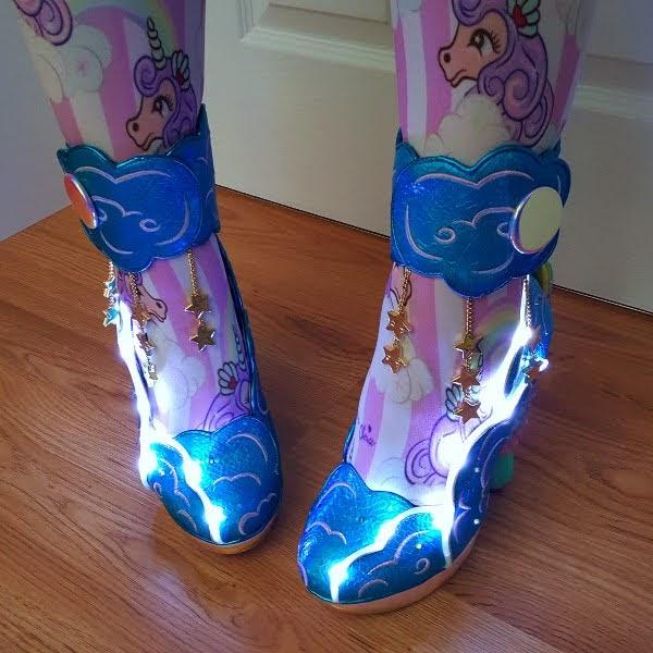 light up Irregular Choice shoes in dark room on feet